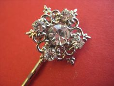 repurposed small vintage brooch into sparkly bobby pin