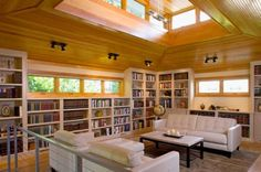 40 Inspiring Home Library Design Ideas For A Stylish Interior: Beautifulnatural Wood And Ample Natural Lighting Accompany This Home Library