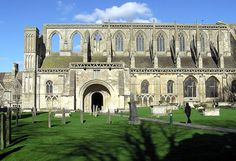 Malmesbury Abbey in Wiltshire, England, is a religious house dedicated to Saint Peter & Saint Paul. It was one of the few English houses with a continual history from the 7th century through to the Dissolution of the Monasteries. The current Abbey was substantially completed by 1180. The 131 m tall spire, & the tower it was built upon, collapsed in a storm around 1500 destroying much of the church.. The west tower fell around 1550... less than half of the original building stands today