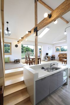 A modern minimal white rustic split level kitchen and dining area