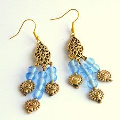 a lovely these blue glass beads with the antique gold settings used to make this pair of handmade jewellery earrings
