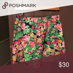 Lilly Pulitzer Skirt I honestly forgot the name of this pattern but it's super cute for it being as old as the print is! Honestly can't remember the original price since I bought it such a long time ago! Only worn a few times, still in good condition and still looks new. Part of the skirt looks black in the picture but it's navy Lilly Pulitzer Skirts
