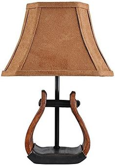 This country western inspired accent lamp features a cowboy stirrup base design and a faux suede shade. Lamp includes a coordinating brown faux suede fabri Western Lamps, Western Decor, Western Cowboy, Rustic Decor, Western Crafts, Equestrian Decor, Rustic Crafts, Western Theme, Western Style