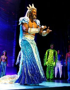 King Triton (Norm Lewis) claps during the curtain call.                                                                                                                                                                                 More