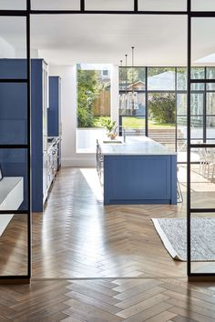Blue kitchen cabinets with oak parquet wood flooring and crittall windows. Blue kitchen cabinets with oak parquet wood flooring and crittall windows. Home Decor Kitchen, Interior Design Kitchen, Modern Interior Design, Interior Decorating, Country Kitchen, Blue Kitchen Cabinets, Design Living Room, Decoration Inspiration, Bespoke Kitchens