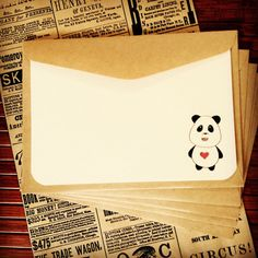 Set of 5 Panda Bear notecards printed on textured acid-free cardstock with recycled kraft envelopes, packaged in a vintage newspaper print bag.    * Flat notecard size - A6 (105 x 148 mm)  * Envelope size - C6 (114 x 162 mm)    This design is a print of my original watercolour illustration.    Printed on ivory cardstock. Other coloured cardstock available. Please contact me for more details.    All items are sent in a rigid cardboard mailer to safeguard from damage.