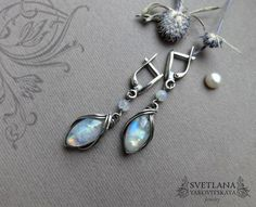 Silver earrings Marquise with gorgeous rainbow moonstones. The earrings made of 925 sterling silver and natural moonstone. Silver patinated and polished by hand. Incredibly beautiful look! These earrings can be a wonderful addition to your image, as well as a memorable gift! Сompletely handmade!  These earrings can be with English locks instead of hooks, if you want.  Length 46 mm (1.8) Width 11mm (0.4 ) Weight of one earring 3g  You can see a video of these earrings on my facebook…