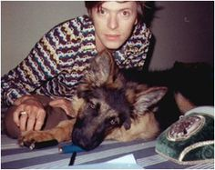 A young David Bowie with a German Shepherd