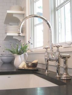 The Perrin & Rowe Ionian Kitchen Tap in Nickel with side pull out hand rinse and crosshead handles. http://www.tapforyou.co.uk/bathroom-sink-taps/led-bathroom-sink-taps/single-handle-waterfall-led-chrome-bathroom-sink-tap-t0801f-