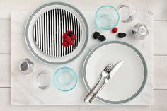 Set the table in style with this Cheeky® Memphis 16-piece porcelain dinnerware set. Great for everyday use, this modern yet classic black and teal set includes 4 mugs, 4 bowls, 4 salad plates, and 4 dinner plates.  Make mealtime matter. With every set you buy, Cheeky will help donate 16 meals* (one meal for every item) to someone who needs it right here in the U.S. through our partnership with Feeding America®.  *For more info on Cheeky's donation program, visit