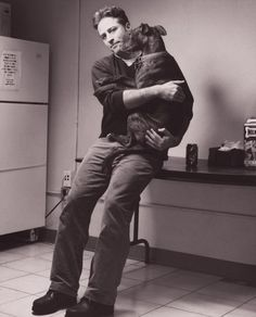 Jon Stewart hugging a dog. I ask you: what's not to love here?