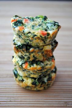 Veggie Quiche Cups  adapted from The South Beach Diet  makes 24 cups (2 cups per serving)  92 calories per 2.  Freezes well.  Very forgiving too... I have added different veggies depending on what I have available - though keep the amount of spinach the same.