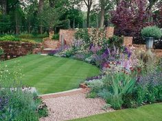 Garden and Landscaping Design Ideas --> http://photos.hgtv.com/rooms/viewer/outdoor-space/lush-green-lawn-and-colorful-flowers-provide-a-lovely-backdrop?soc=pinterest