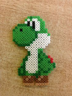 Hama Beads Yoshi Source by christinsteinfe You may believe that the history of handcrafted beaded je Melty Bead Patterns, Pearler Bead Patterns, Perler Patterns, Beading Patterns, Peyote Patterns, Quilt Patterns, Hama Beads Mario, Diy Perler Beads, Hamma Beads 3d
