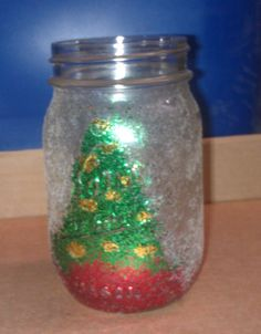 Turn an old jar into a festive candle holder with some glitter and glue (and some patience, I'm not going to lie, this was messy).