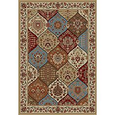 Instantly transform your space with this multi colored traditional jewel toned area rug. Machine woven of soft polypropylene makes for easy care and long lasting durability.http://www.overstock.com/Home-Garden/Wentworth-Ivory-Panel-Rug-710-x-910/6430634/product.html?CID=214117 $131.99