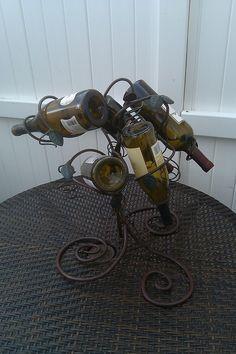wrought iron wine rack by Irishiron on Etsy, $75.00