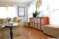 toy storage for living room--canvas boxes on shelf and two storage ottomans on either side