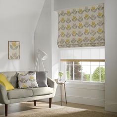 Our made to measure Roman blinds offer that modern alternative to curtains; all are fully lined, with an option of blackout lining. Here in yellow and grey pattern. Scallops and rings are available on request. We will even create a blind using your own fabric!