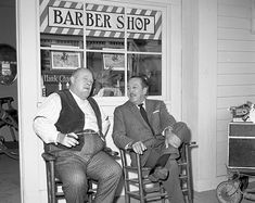 Burl Ives and Walt chat on the front porch of the Beulah barbershop.