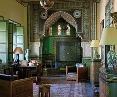 The Salon Vert, Villa Oasis. The Salon Vert. The consoles on the right were painted by Jacques Majorelle, who was responsible for the original layout of the villa and its garden. Photo by Oberto Gili. The Wall Street Journal. Moroccan Design, Moroccan Decor, Moroccan Style, Moroccan Bedroom, Modern Moroccan, Moroccan Lanterns, Design Marocain, Moroccan Interiors, Islamic Architecture