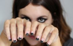 We cannot get enough of this black cat mani! Perfect for Halloween, but really...we'd wear this ANY day of the year.