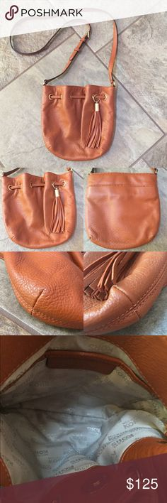 MICHAEL KORS Leather Ring Crossbody BUNDLE & SAVE 30% This is a rust/burnt orange colored pebble leather, has shiny gold hardware, magnetic snap closure, decorative hanging leather tassel, there is a back slip pocket with magnetic closure, adjustable crossbody strap, interior has one slip pocket, 9in(L) 9in(H) strap is 23in at its longest. Used once! EXCELLENT condition! Michael Kors Bags Crossbody Bags