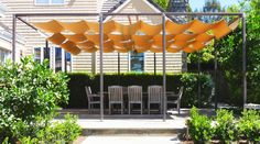 Retractable options let you choose when you want shade or sun. When it's the former, this playful design folds out strips of yellow fabric to protect you from the rays.