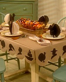 Kid's table - silhouette tablecloth and coloring-book place cards