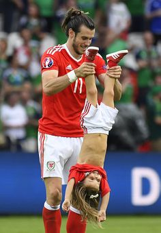 #EURO2016 Wales' forward Gareth Bale holds his daughter Alba Viola following the Euro 2016 round of sixteen football match Wales vs Northern Ireland on June 25...