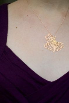 gold 24kt gold plated stainless steel pendant formed from an intricate hexagonal mesh. A miniaturized version of the radiolaria brooch, its small size accentuates the delicacy of the design.