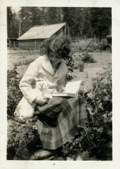 vintage photo Lady Reads Book Cuddling Her Cat