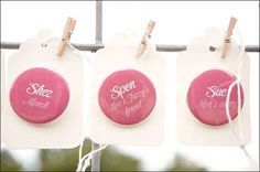 Have customized buttons for the immediate families (or all of the wedding guests) instead of name tags.