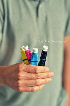 hand holding paint tubes