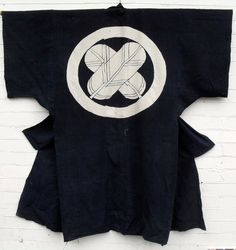 """Dating to the Meiji period (1868-1912), this superb Japanese indigo sleeping cover is called a """"yogi"""" (literally """"night wear""""). I sewn into the shape of"""