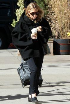 Ashley in an oversized coat.