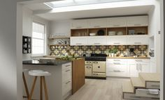 Linda Barker kitchen for Wren with white units and colourful tiles