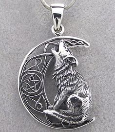 Something like this without the stuff in the moon, or a wolf print for charm bracelet tattoo
