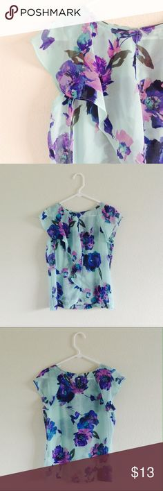 ruffle-front sheer top New without tags ruffle-front sheer top. Keyhole detail on back. Robins-egg blue with violet, lavender, and cerulean flower print. Size S, 100% polyester. Tops