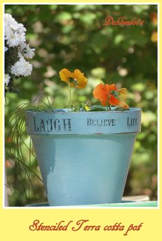 Painted and stenciled terra cotta pot with pansies