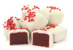 Red Velvet Caramels -- Sink your teeth into these delicious and soft gourmet caramels. Fresh Red Velvet flavored caramel coated in white chocolate and then topped with a few sprinkles for just a little crunch. We guarantee you haven't tasted anything like this before.