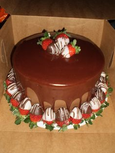 Chacolate cake with chocolate buttercream with chocolate ganache ( i cheat and use canned fudge frosting heated in the microwave) drizzle, topped with fresh dipped strawberries.