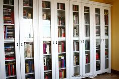 This is the Yellow Library in Wanda's house in the Philippines. It comprises a wall of very nice white-painted, glass door-fronted bookcases, as well as some lovely and comfortable furnishings. Many of the standard library furniture and accessories have been included here: globe, busts, interesting bookends, wing chair and footstool, sheepskin rug and writing desk. The library contains about 650 books.    For an overview of how an ordinary bedroom was converted into this library, see here…