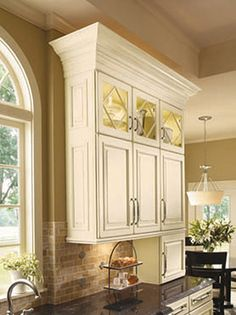 Love the over-sized moulding that changes an ordinary cabinet to an extraordinary cabinet! Inexpensive, too!