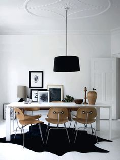 A beautiful light home in Denmark with all of my favorite chairs in one space.  I love the wooden and black details in the white room!