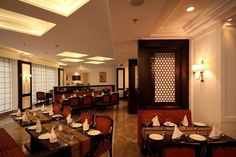 Dine in style in the elegant, warm and ambient restaurant at Country Inn & Suites By Carlson, Satbari, Delhi...
