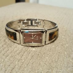 Relic bangle tortiouse watch Like brand new,  worn only one time,  beautiful Relic brand bangle watch with clasp closure,  silver and tortoise detail,  does need new battery Relic Accessories Watches