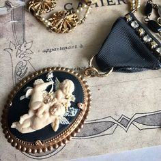 Cherub Rock - Vintage assemblage necklace by Alpha Female Studio.