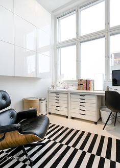Via Lily P | Eames Lounge Chair | IKEA Stockholm - great idea with the desk top on top of the 2 filing drawer units... :)