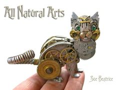 """Can't bear to throw away that old, broken pocket watch sitting in your sock drawer? Try turning it into a piece of steampunk-inspired art instead! That's what New York-based artist Sue Beatrice did. Chat Steampunk, Steampunk Kunst, Steampunk Cosplay, Steampunk Fashion, Types D'art, Steampunk Animals, Clock Parts, Old Clocks, Junk Art"